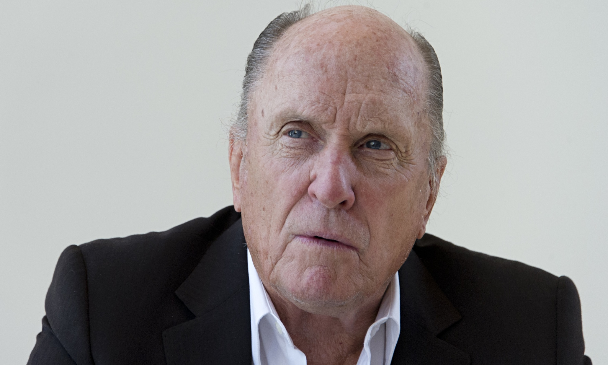 The 86-year old son of father William Howard DuVall and mother Mildred Virginia Hart DuVall, 177 cm tall Robert Duvall in 2017 photo