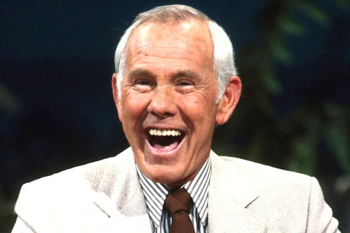 "Comedian Johnny Carson, the king of U.S. late-night television as host of NBC's 'The Tonight Show' for nearly 30 years -- and the last face millions of Americans saw before drifting off to sleep -- died on January 23, 2005 at age 79. Carson's topical opening monologues and on-air banter with sidekick Ed McMahon and bandleader Doc Severinsen made his show a cultural touchstone, and his death saddened many in Hollywood who got their first big break on the program. Carson is shown on the ""Tonight Show"" in an undated photo.  REUTERS/NBC NO SALES"