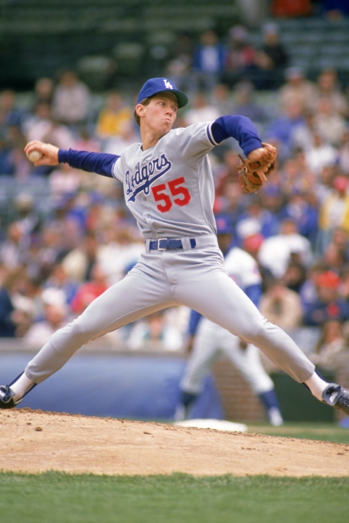 CHICAGO - 1989: Orel Hershiser #55 of the Los Angeles Dodgers pitches against the Chicago Cubs in the 1989 season at Wrigley Field in Chicago, Illinois. (Photo by Jonathan Daniel/Getty Images)